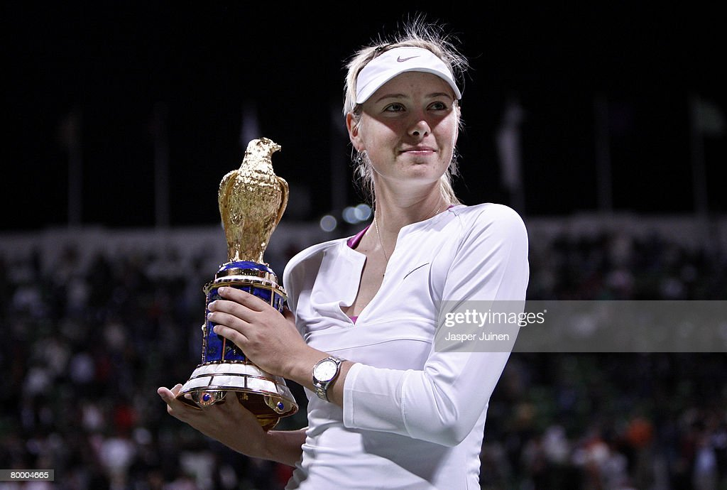 Maria Sharapova of Russia holds up the Golden Falcon award after winning her WTA Qatar Total Open final match against Vera Zvonareva of Russia on day...