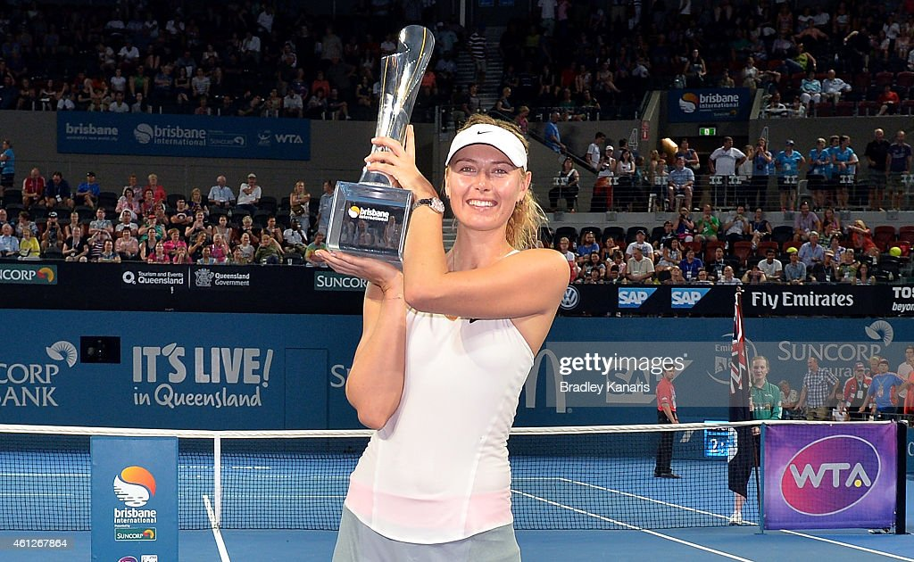 Maria Sharapova of Russia holds up the winners trophy after the Women's finals match against Ana Ivanovic of Serbia during day seven of the 2015...