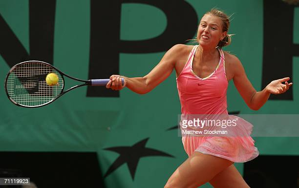 Maria Sharapova of Russia in action against Dinara Safina of Russia during day eight of the French Open at Roland Garros on June 4 2006 in Paris...