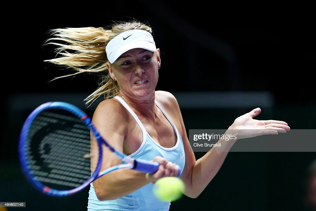 Maria Sharapova of Russia in action against Flavia Pennetta of Italy in a round robin match during the BNP Paribas WTA Finals at Singapore Sports Hub on October 29, 2015 in Singapore.