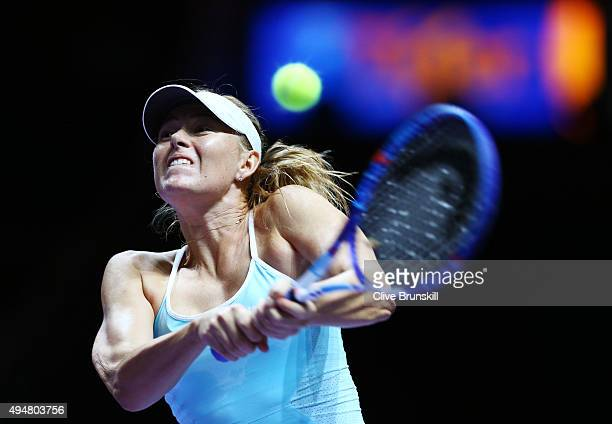 Maria Sharapova of Russia in action against Flavia Pennetta of Italy in a round robin match during the BNP Paribas WTA Finals at Singapore Sports Hub...