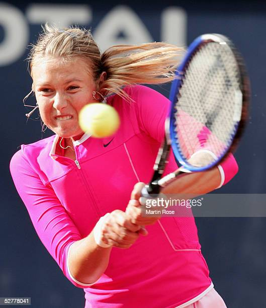 Maria Sharapova of Russia in action against Justine HeninHardenne of Belgium during the Qatar Total German Open on May 6 2005 in Berlin Germany