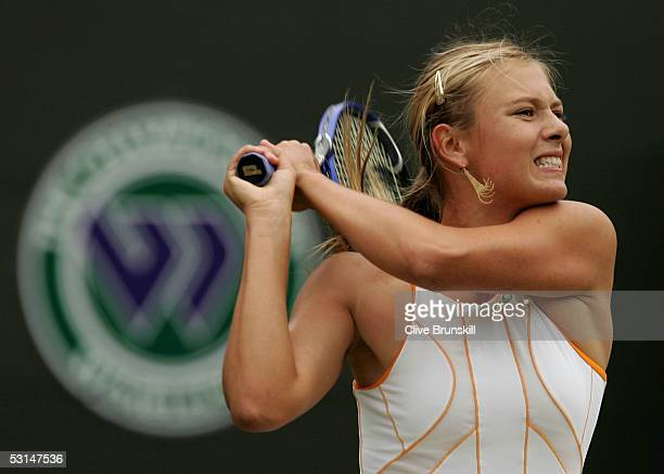 Maria Sharapova of Russia in action against Katarina Srebotnik of Slovenia during the sixth day of the Wimbledon Lawn Tennis Championship on June 25...