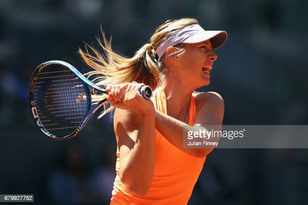 Maria Sharapova of Russia in action against Mirjana LucicBaroni of Croatia during day two of the Mutua Madrid Open tennis at La Caja Magica on May 7...