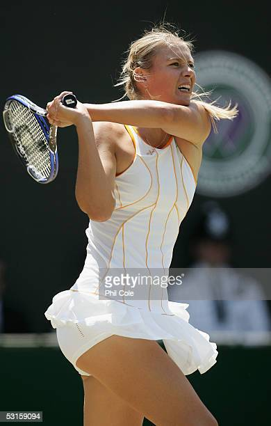 Maria Sharapova of Russia in action against Nadia Petrova of Russia during the eighth day of the Wimbledon Lawn Tennis Championship on June 28 2005...