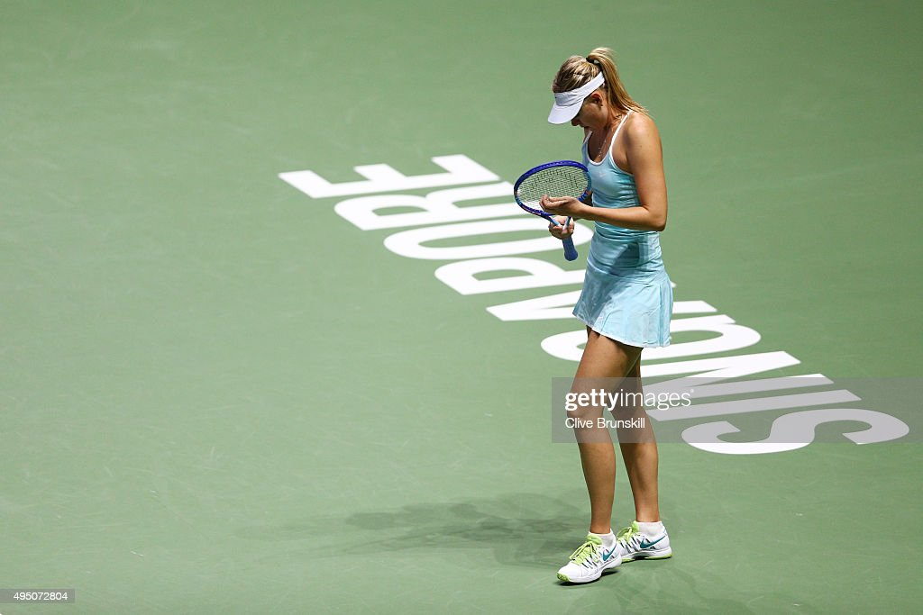 Maria Sharapova of Russia in action against Petra Kvitova of Czech Republic in the semi-final match of the BNP Paribas WTA Finals at Singapore Sports Hub on October 31, 2015 in Singapore.