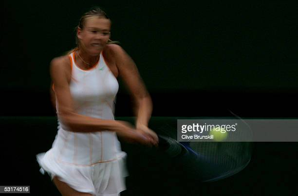 Maria Sharapova of Russia in action against Venus Williams of USA during the tenth day of the Wimbledon Lawn Tennis Championship on June 30 2005 at...