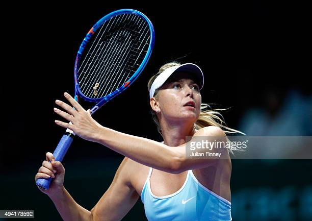 Maria Sharapova of Russia in action during a round robin match againt Agnieszka Radwanska of Poland during the BNP Paribas WTA Finals at Singapore...