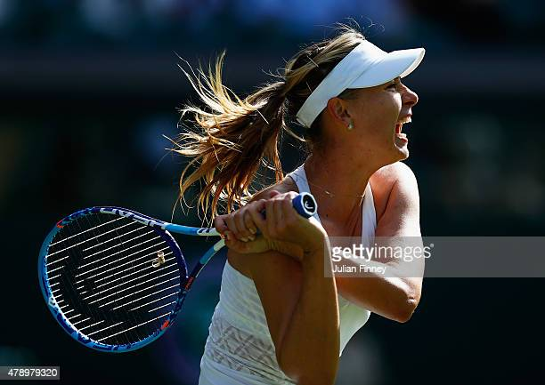 Maria Sharapova of Russia in action in her Ladies's Singles first round match against Johanna Konta of Great Britain during day one of the Wimbledon...