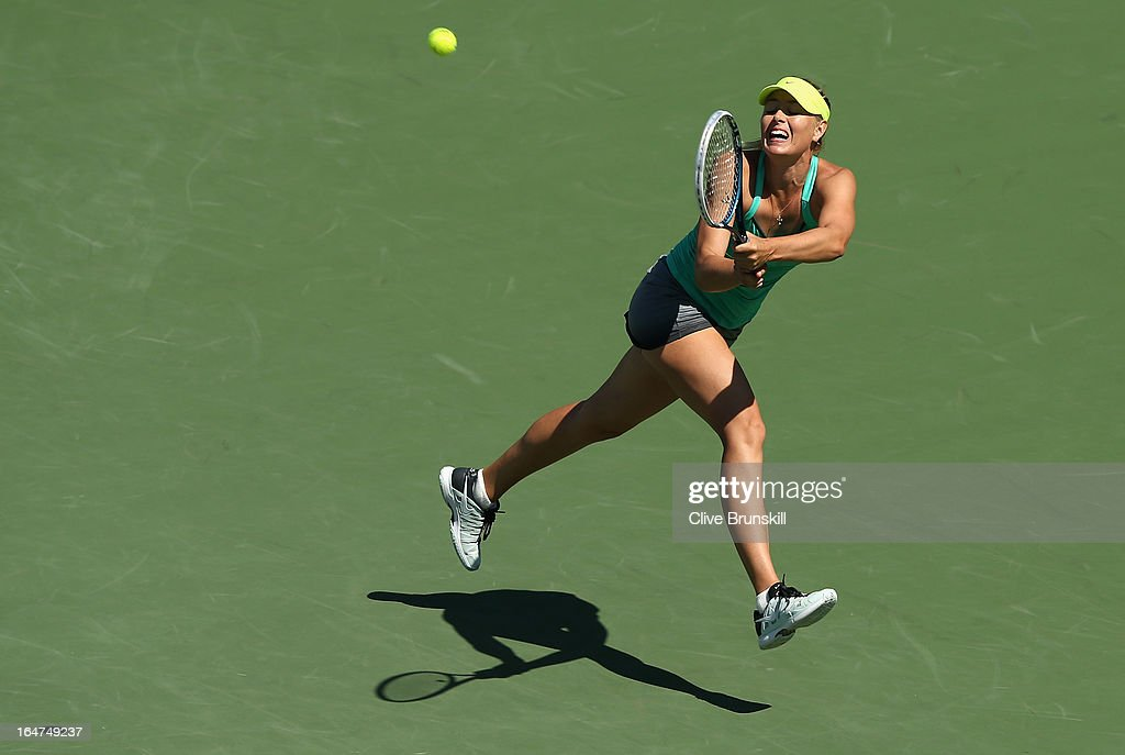 Maria Sharapova of Russia jumps to play a backhand against Sara Errani of Italy during their quarter final match at the Sony Open at Crandon Park Tennis Center on March 27, 2013 in Key Biscayne, Florida.