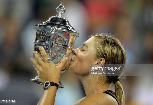 Maria Sharapova of Russia kisses the championship trophy after her straight set victory over Justine HeninHardene of Belgium in the final of the US...