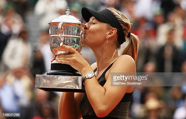 Maria Sharapova of Russia kisses the Coupe Suzanne Lenglen after the women's singles final against Sara Errani of Italy during day 14 of the French...