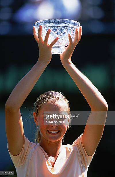 Maria Sharapova of Russia lifts the trophy after victory in the junior girls singles during the Nasdaq100 Open at the Tennis Center at Crandon Park...