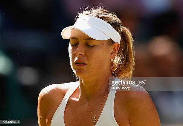 Maria Sharapova of Russia looks dejected in the Ladies Singles Semi Final match against Serena Williams of the United States during day ten of the...