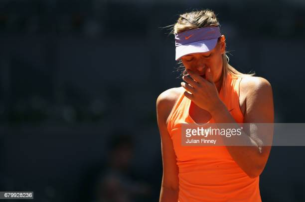 Maria Sharapova of Russia looks on in her match against Mirjana LucicBaroni of Croatia during day two of the Mutua Madrid Open tennis at La Caja...