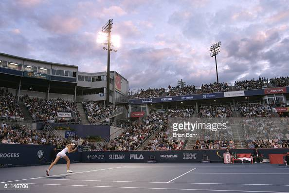 Maria Sharapova of Russia lunges for a serve from Vera Zvonareva of Russia during their third round match of Rogers Cup tennis on August 5 2004 at...