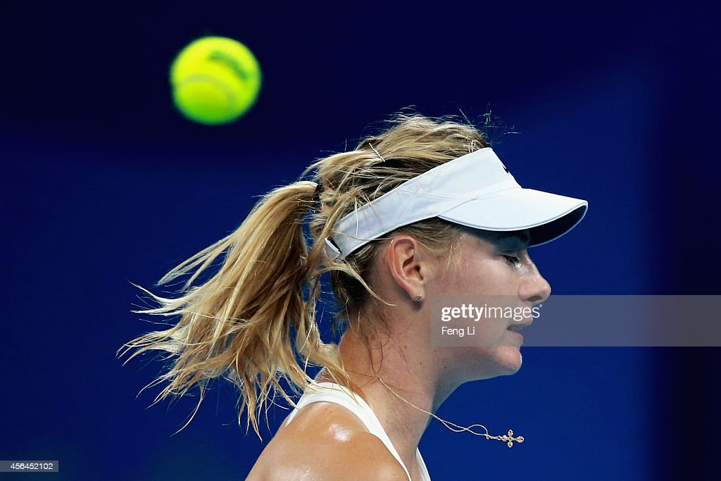 Maria Sharapova of Russia misses a ball against Carla Suarez Navarro of Spain during day five of the China Open at the China National Tennis Center on October 1, 2014 in Beijing, China.