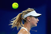 Maria Sharapova of Russia misses a ball against Carla Suarez Navarro of Spain during day five of the China Open at the China National Tennis Center...