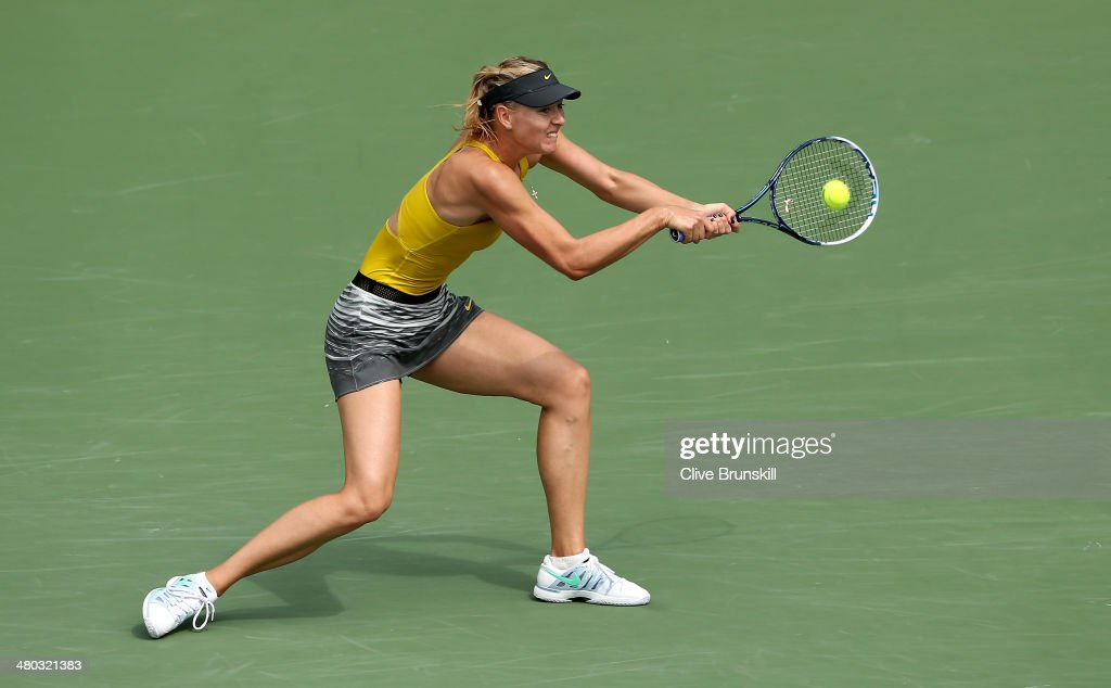 Maria Sharapova of Russia plays a backhand against Kirsten Flipkens of Belgium during their fourth round match during day 8 at the Sony Open at Crandon Park Tennis Center on March 24, 2014 in Key Biscayne, Florida.