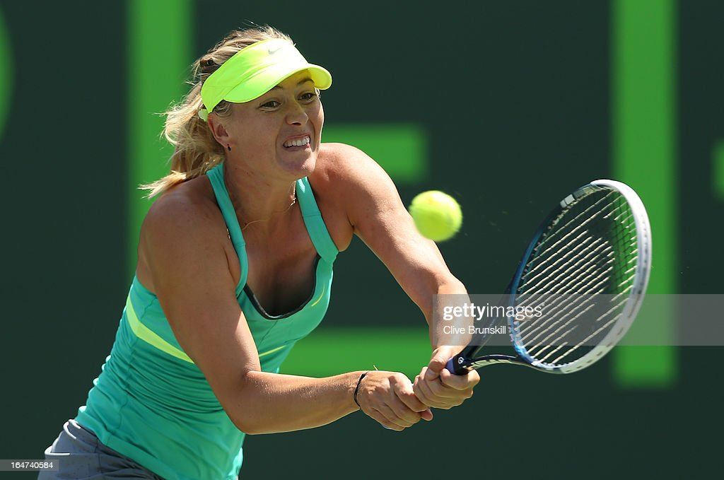Maria Sharapova of Russia plays a backhand against Sara Errani of Italy during their quarter final match at the Sony Open at Crandon Park Tennis Center on March 27, 2013 in Key Biscayne, Florida.