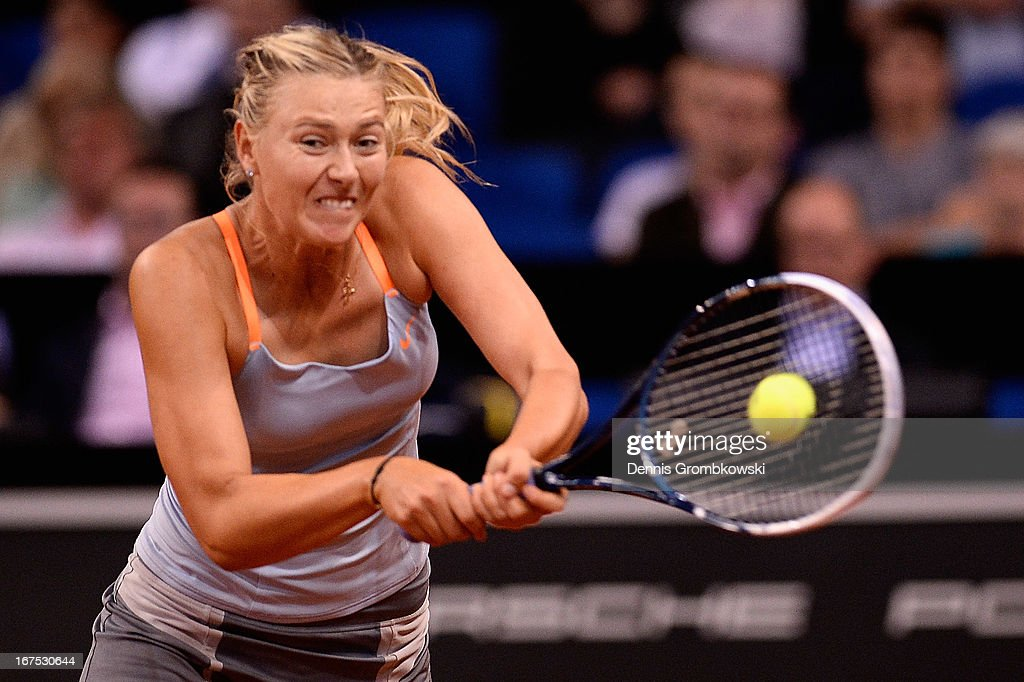Maria Sharapova of Russia plays a backhand in her match against Ana Ivanovic of Serbia during Day 5 of the Porsche Tennis Grand Prix at Porsche-Arena on April 26, 2013 in Stuttgart, Germany.