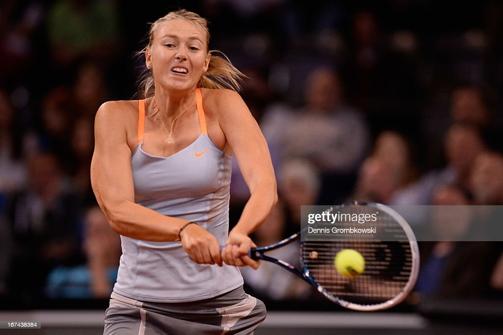 Maria Sharapova of Russia plays a backhand in her match against Lucie Safarova of Czech Republic during Day 4 of the Porsche Tennis Grand Prix at Porsche-Arena on April 25, 2013 in Stuttgart, Germany.