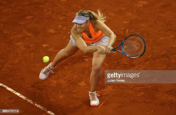 Maria Sharapova of Russia plays a backhand in her match against Eugenie Bouchard of Canada pass at the net in their match during day three of the...
