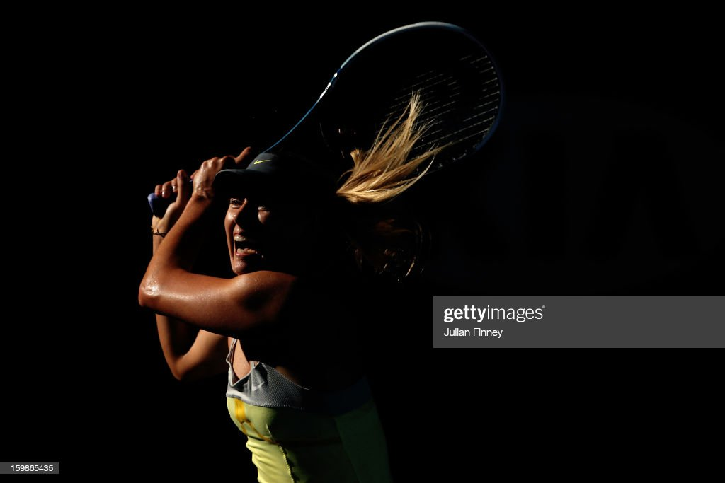<a gi-track='captionPersonalityLinkClicked' href=/galleries/search?phrase=Maria+Sharapova&family=editorial&specificpeople=157600 ng-click='$event.stopPropagation()'>Maria Sharapova</a> of Russia plays a backhand in her Quarterfinal match against Ekaterina Makarova of Russia during day nine of the 2013 Australian Open at Melbourne Park on January 22, 2013 in Melbourne, Australia.