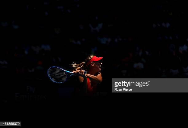 Maria Sharapova of Russia plays a backhand in her second round match against Alexandra Panova of Russia during day three of the 2015 Australian Open...