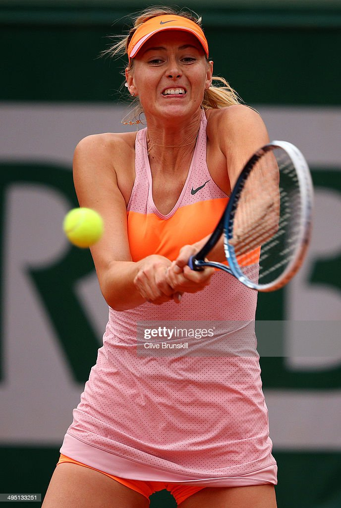 <a gi-track='captionPersonalityLinkClicked' href=/galleries/search?phrase=Maria+Sharapova&family=editorial&specificpeople=157600 ng-click='$event.stopPropagation()'>Maria Sharapova</a> of Russia plays a backhand in her women's singles match against Samantha Stosur of Australia on day eight of the French Open at Roland Garros on June 1, 2014 in Paris, France.