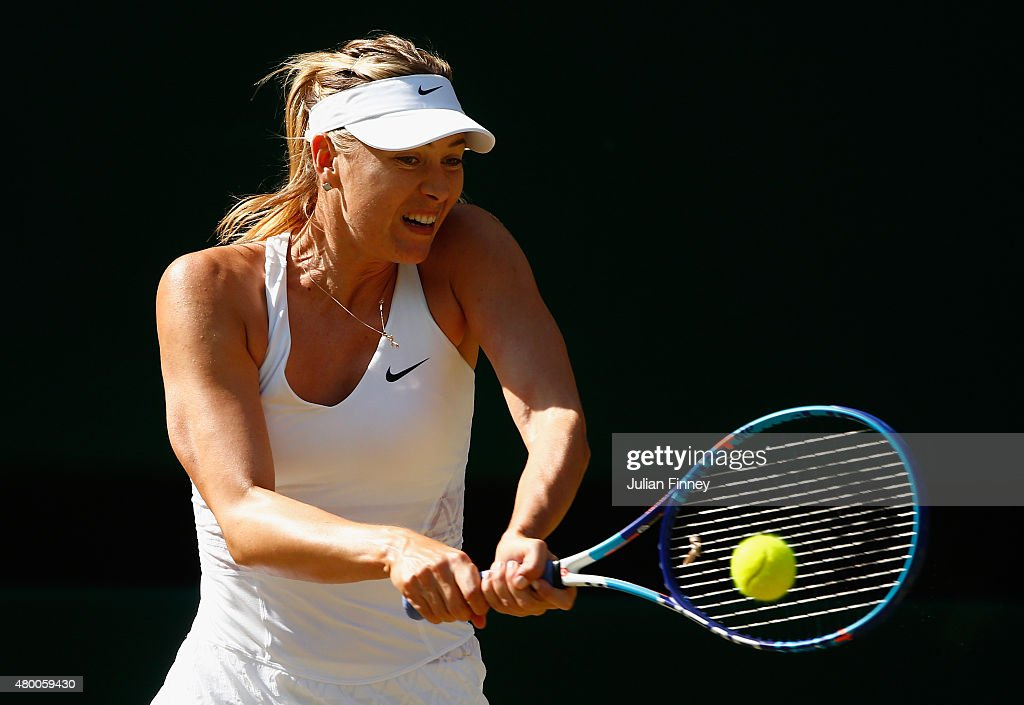 <a gi-track='captionPersonalityLinkClicked' href=/galleries/search?phrase=Maria+Sharapova&family=editorial&specificpeople=157600 ng-click='$event.stopPropagation()'>Maria Sharapova</a> of Russia plays a backhand in the Ladies Singles Semi Final match against Serena Williams of the United States during day ten of the Wimbledon Lawn Tennis Championships at the All England Lawn Tennis and Croquet Club on July 9, 2015 in London, England.