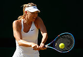 Maria Sharapova of Russia plays a backhand in the Ladies Singles Semi Final match against Serena Williams of the United States during day ten of the...