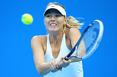 Maria Sharapova of Russia plays a backhand in the Women's Single Final against Petra Kvitova of the Czech Republic on day nine of the China Open at...