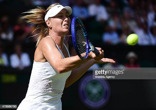 Maria Sharapova of Russia plays a forehand against Johanna Konta of Great Britain during day one of the Wimbledon Lawn Tennis Championships at the...
