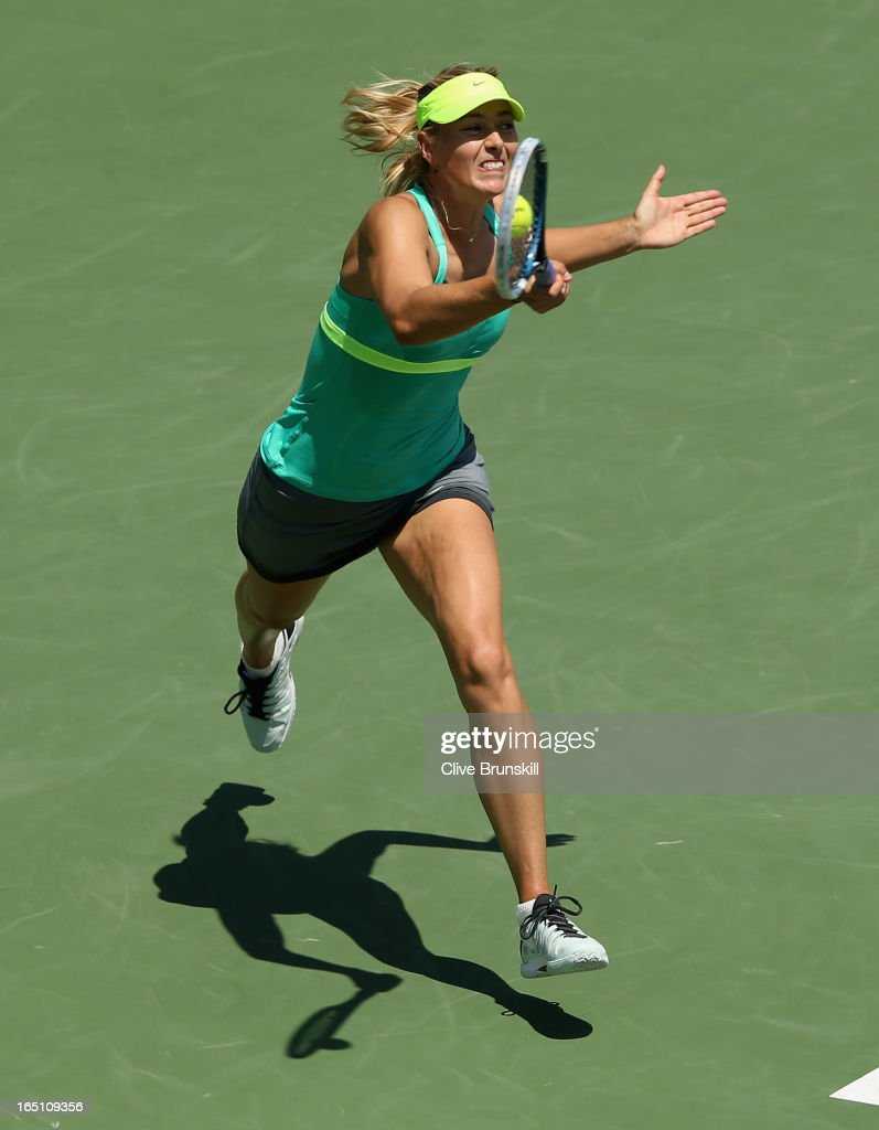 <a gi-track='captionPersonalityLinkClicked' href=/galleries/search?phrase=Maria+Sharapova&family=editorial&specificpeople=157600 ng-click='$event.stopPropagation()'>Maria Sharapova</a> of Russia plays a forehand against Serena Williams during their final match at the Sony Open at Crandon Park Tennis Center on March 30, 2013 in Key Biscayne, Florida.