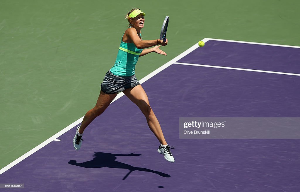 Maria Sharapova of Russia plays a forehand against Serena Williams during their final match at the Sony Open at Crandon Park Tennis Center on March 30, 2013 in Key Biscayne, Florida.