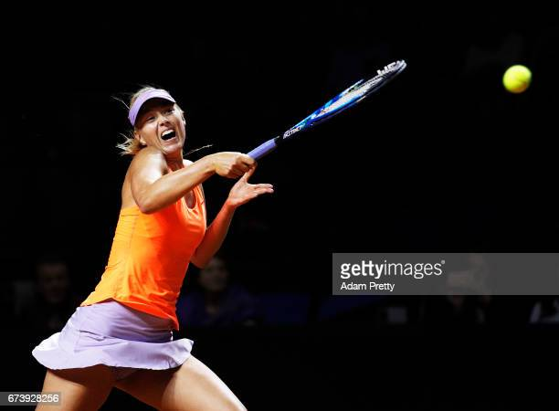 Maria Sharapova of Russia plays a forehand during her match against Erkaterina Makarova of Russia during the Porsche Tennis Grand Prix at Porsche...