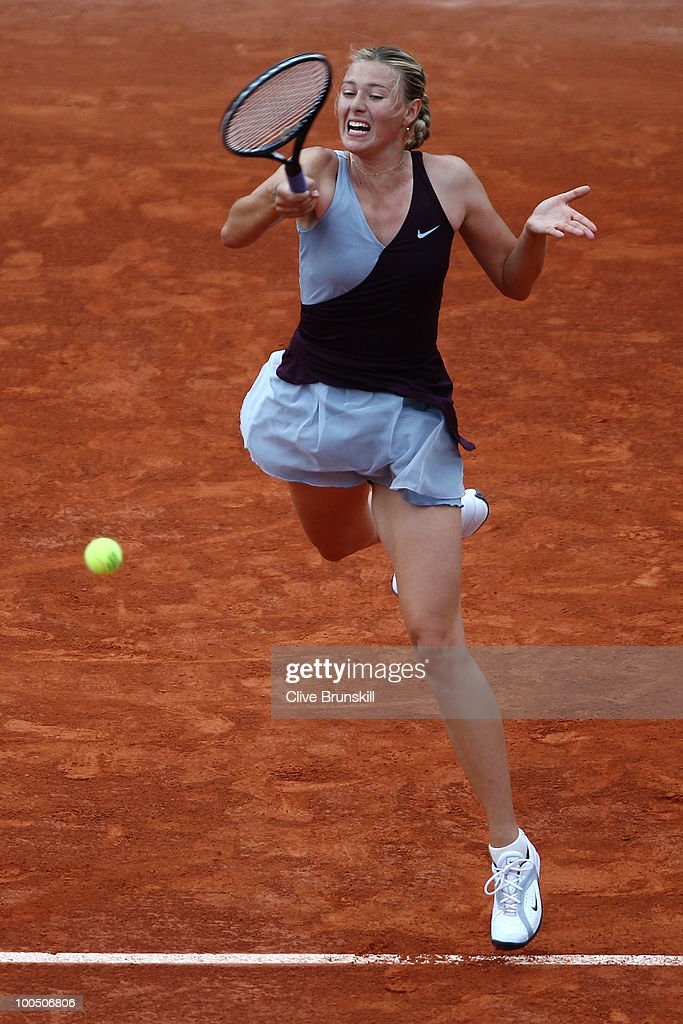 Maria Sharapova of Russia plays a forehand during the women's singles first round match between Maria Sharapova of Russia and Ksenia Pervak of Russia on day three of the French Open at Roland Garros on May 25, 2010 in Paris, France.