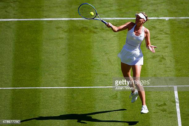 Maria Sharapova of Russia plays a forehand in her Ladies's Singles first round match against Johanna Konta of Great Britain during day one of the...