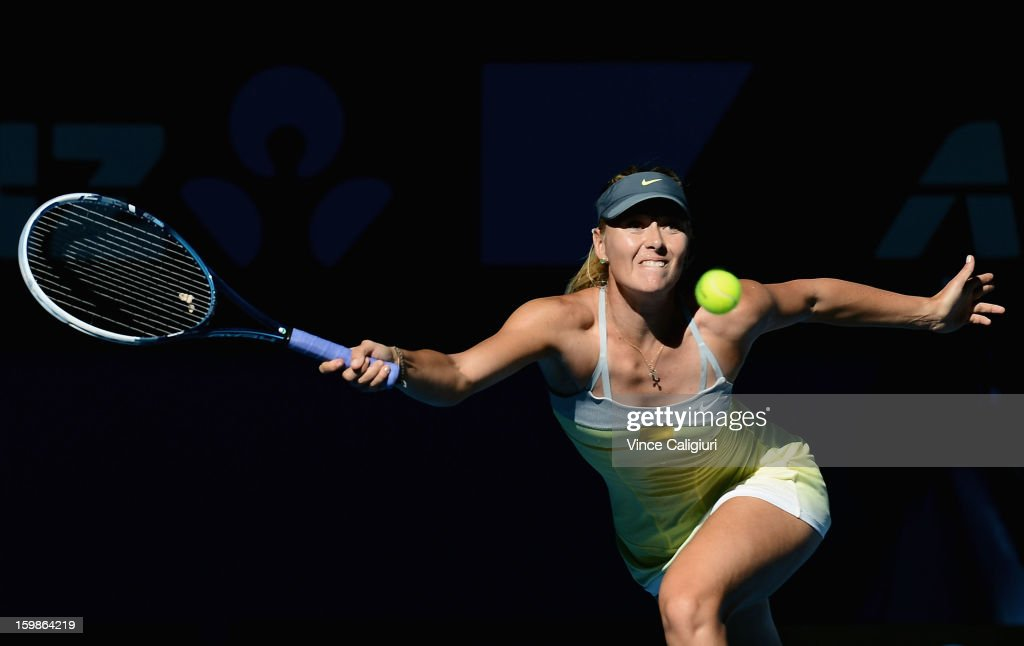 <a gi-track='captionPersonalityLinkClicked' href=/galleries/search?phrase=Maria+Sharapova&family=editorial&specificpeople=157600 ng-click='$event.stopPropagation()'>Maria Sharapova</a> of Russia plays a forehand in her Quarterfinal match against Ekaterina Makarova of Russia during day nine of the 2013 Australian Open at Melbourne Park on January 22, 2013 in Melbourne, Australia.