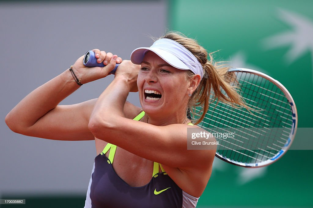 Maria Sharapova of Russia plays a forehand in her womens' singles semi-final match against Victoria Azarenka of Belarus against during day twelve of the French Open at Roland Garros on June 6, 2013 in Paris, France.