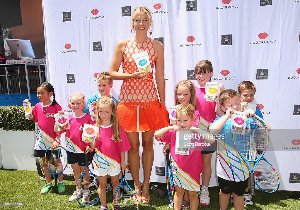 <a gi-track='captionPersonalityLinkClicked' href=/galleries/search?phrase=Maria+Sharapova&family=editorial&specificpeople=157600 ng-click='$event.stopPropagation()'>Maria Sharapova</a> of Russia poses during the launch of <a gi-track='captionPersonalityLinkClicked' href=/galleries/search?phrase=Maria+Sharapova&family=editorial&specificpeople=157600 ng-click='$event.stopPropagation()'>Maria Sharapova</a>'s new brand 'Sugarpova' at Crown Entertainment Complex on January 11, 2013 in Melbourne, Australia.