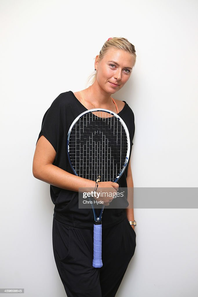 <a gi-track='captionPersonalityLinkClicked' href=/galleries/search?phrase=Maria+Sharapova&family=editorial&specificpeople=157600 ng-click='$event.stopPropagation()'>Maria Sharapova</a> of Russia poses for a photograph during day one of the 2014 Brisbane International at Queensland Tennis Centre on December 29, 2013 in Brisbane, Australia.