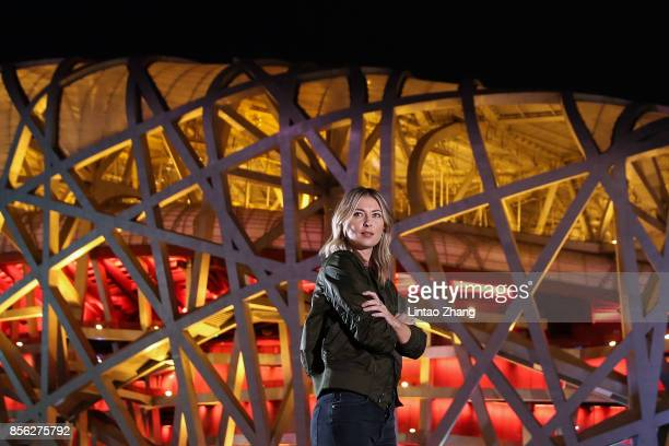 Maria Sharapova of Russia poses for a picture front of the National Stadium before the 2017 China Open Player Party on October 1 2017 in Beijing China