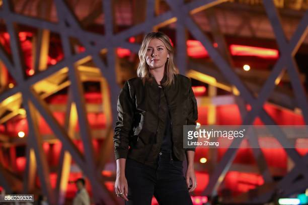 Maria Sharapova of Russia poses for a picture in front of the National Stadium before the 2017 China Open Player Party on October 1 2017 in Beijing...