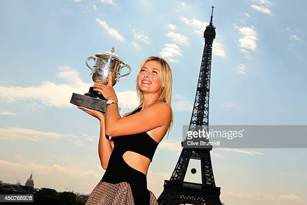 Maria Sharapova of Russia poses in front of the Eiffel Tower with the Coupe Suzanne Lenglen at Trocadero following her victory in the women's singles...