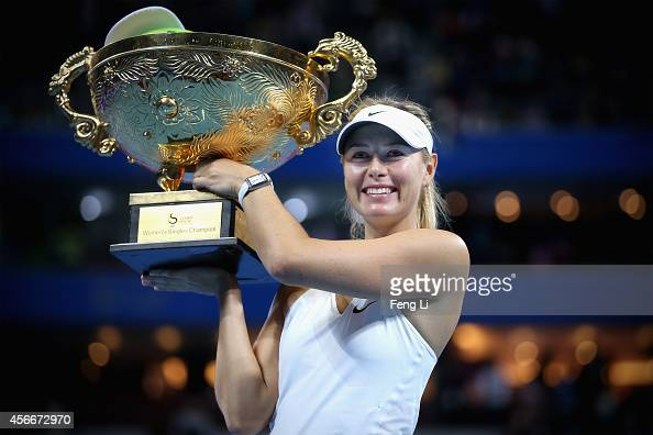 Maria Sharapova of Russia poses with her trophies during the medal ceremony after the Women's Single Final on day nine of the China Open at the China...