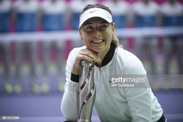 Maria Sharapova of Russia poses with her trophy after winning her women's singles final match against Aryna Sabalenka of Belarus at the Tianjin Open...
