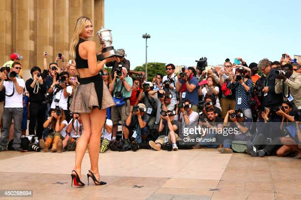 Maria Sharapova of Russia poses with the Coupe Suzanne Lenglen at Trocadero following her victory in the women's singles final match against Simona...