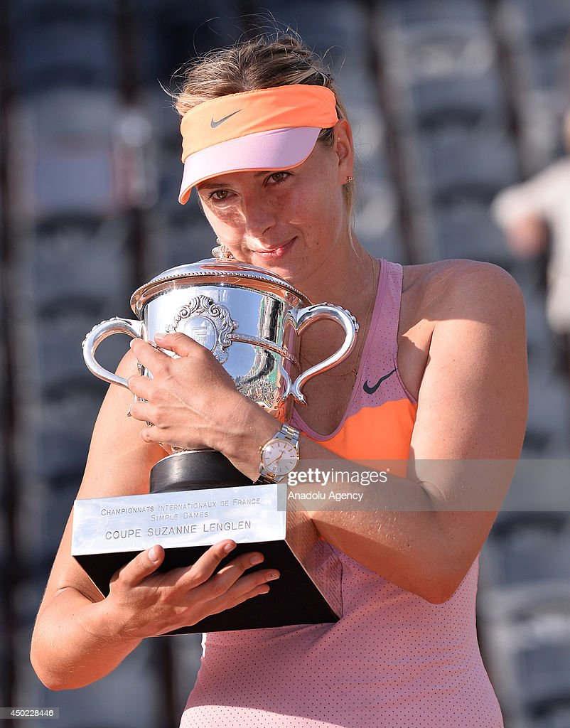 Maria Sharapova of Russia poses with the trophy after winning the final match of the French Open tennis tournament against Simona Halep of Romania at Roland Garros Stadium in Paris, France on June 7, 2014